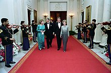 The Reagans and the Paul walking a red carpet during the 1987 Dinner Honoring the Nation's Governors