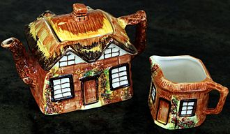 Kitsch - A mass-produced teapot and milk tankard set, themed like an old cottage.