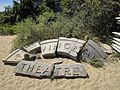 Provincetown Theater granite arch on beach behind whalers wharf.jpg