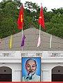 Public Building with Flags and Ho Chi Minh Portrait - Dien Bien Phu - Vietnam (48159136271).jpg