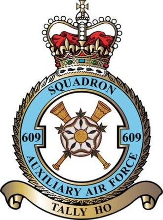 No. 609 Squadron RAF - In front of two hunting horns in saltire, a white Yorkshire rose.