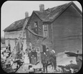 Residents in front of a dilapidated frame house in Kansas City, ca. 1900 - NARA - 535470.tif