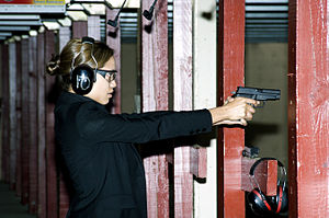 United States Air Force Office of Special Investigations - Rosario Dawson fires a M11 pistol at the firing range at Andrews Air Force Base, while researching her role in Eagle Eye.