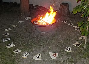 Brazier - Brazier with burning fire in a rune stone circle at a summer solstice