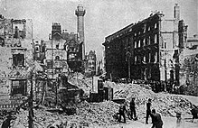 external scene showing ruined buildings in a city street