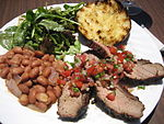 Santa Maria-style barbecue: Tri-tip with salsa, pink beans instead of pinquito beans, salad, and garlic bread.