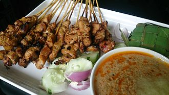 Malay Singaporeans - A Satay being served in Singapore. Quintessentially Javanese in origin, the dish is now known as part and parcel of Singaporean Malay cuisine, reflecting the visible Javanese ancestry of many Malays in the republic.