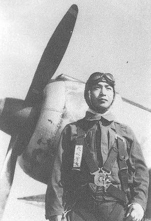 Satoru Anabuki - Satoru Anabuki poses in front of a Nakajima Ki-43 aircraft in late 1944.