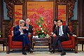 Secretary Kerry Takes a Sip of Team While Sitting With Chinese Premier Li Keqiang (17100516853) (2).jpg
