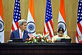 Secretary Kerry listens while Foreign Minister Sushma Swaraj addresses reporters during news conference following strategic dialogue (1).jpg
