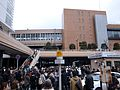 Sendai 2011 people gathered in front of the station (5541814110).jpg