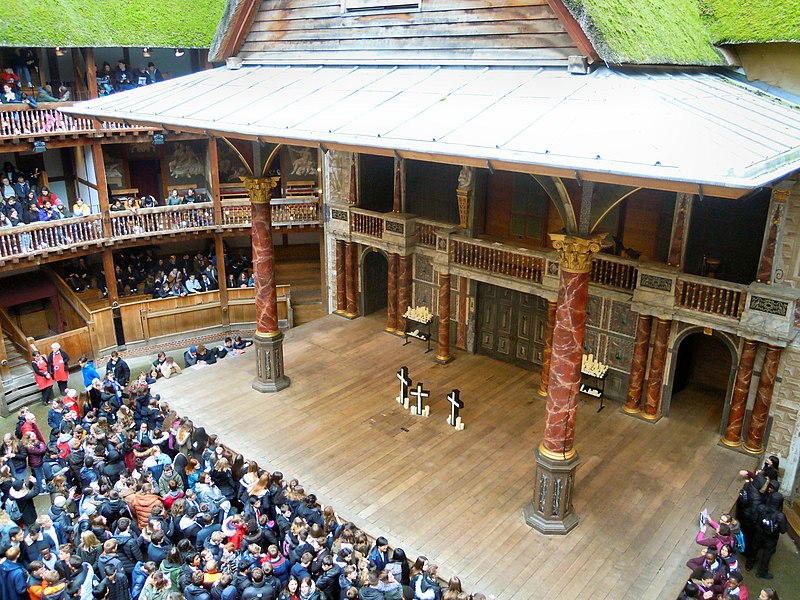 View of Shakespeare's Globe Theatre stage set up for a performance of Romeo and Juliet.