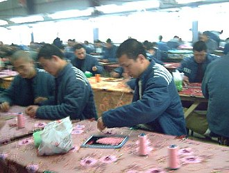 Re-education through labor - Workers in the Shayang Re-education Through Labor camp; photo from the archives of the Laogai Museum
