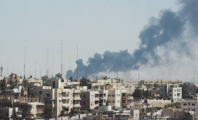 Smoke rises above Amman during Black September