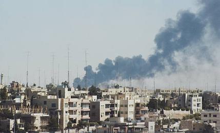 Smoke rises above Amman during Black September, 1 October 1970