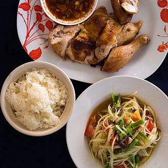 Green papaya salad - Green papaya salad, grilled chicken and sticky rice is a popular combination in Thailand