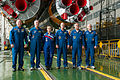Soyuz TMA-12M crew and backup crew in front of their booster rocket.jpg