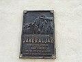 Spominska plošča na rojstni hiši Jakoba Aljaža.jpg