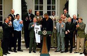 Tim Duncan - Duncan (middle) and the Spurs at the White House after winning the 2003 NBA Finals