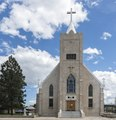 St. Mary's Catholic Church, built in 1900 in Walsenburg, Colorado. The building lost its tall steeple in a 1931 windstorm LCCN2015632558.tif