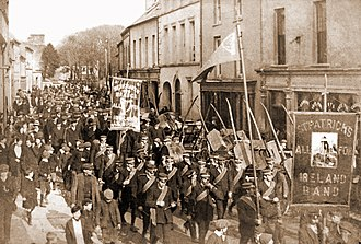 All-for-Ireland League - All-for-Ireland fife and drum band parading through Castletownbere co. Cork in 1910.  Towns often had rival AFIL and AOH bands, occasionally clashing on Sunday parades.