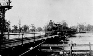 Western railway line, Queensland - Passenger train on the Bridge across Charley's Creek, Chinchilla during the 1921-22 floods