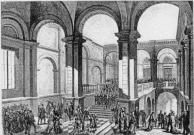 """Student singers marching down the staircase in Carolina Rediviva, on the occasion of the 400th anniversary of the university in 1877. The """"staircase march"""" (trappmarschen) when the singers led the audience in a march out of the hall where the concert was held, is an annual tradition that was later moved to the new main university building completed in 1887. (The monumental staircase of Carolina was later sacrificed to create more storage space for books.)"""