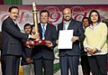 Subhash Ramrao Bhamre presenting the award for the best tableau to the Ministry of Skill Development and Entrepreneurship under Union MinistriesDepartments category for its float on 'Skill India', in Republic Day Parade-2017.jpg