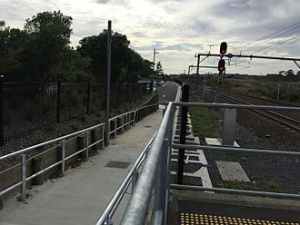 Swanson railway station - Footpath leading to a carpark.Photo faces east and is taken from platform 1.