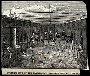 """TS Indefatigable - Swimming bath on the training ship """"Indefatigable"""" at Liverpool. Wood engraving."""