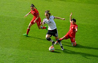 Turkey women's national football team - Turkey's attack being stopped by Sara Däbritz (white/black) of Germany at the UEFA Women's Euro 2017 qualifying Group 5 match on April 8, 2016.