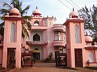 Ornate, pink-and-white building with traditional Mughal architecture