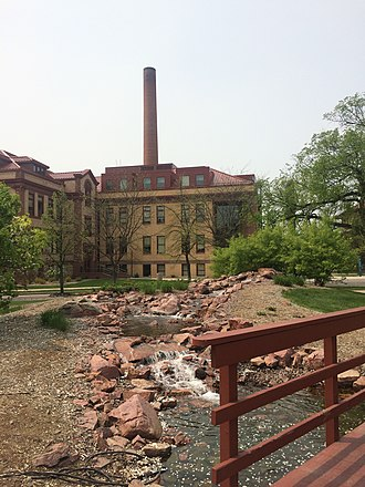 North Dakota State University - The Babbling Brook with Minard Hall and Heating Plant in the Background