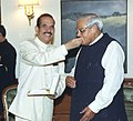 The Speaker of Lok Sabha Shri Manohar Joshi offering sweets to the Prime Minister Shri Atal Bihari Vajpayee on his 79th birthday in New Delhi on December 25, 2003.jpg