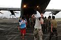 The crew of a Royal Air Force C130 transport aircraft deliver food aid and clean drinking water to people recovering from Typhoon Haiyan (10963784903).jpg