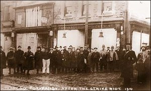 Tonypandy riots - Residents standing outside the now boarded shops after the events of 8 November