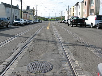 L Taraval - The original end of the L Taraval line, before the 1937 extension south of Taraval Street, with tracks still in place as a short branch, not normally used. Trains are usually sent here to turn back early, and these are the only tracks left in San Francisco that are embedded in sett.