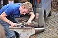 Traditional blacksmith forging a horseshoe. (3557420634).jpg
