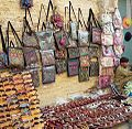 Traditional embroidered purses hanging on a shop in market near Delhi Gate Lahore.jpg