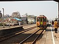 Train arriving at TRA Jhudong Station 01.jpg