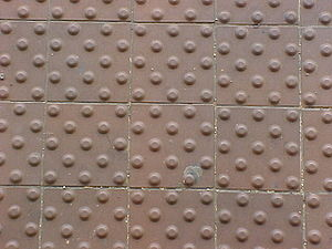 Tactile paving - Truncated dome tiles along the platform edge at the King Street – Old Town Metro train station in Alexandria, Virginia.