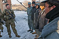 U.S. Army 1st Lt. Clayton Smith, left, debriefs Afghan policemen in the courtyard of their police headquarters following a presence patrol at Gardez, Paktia province, Afghanistan, Feb 120216-A-ZU930-030.jpg