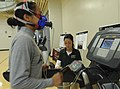 U.S. Army Spc. Alejandra Herrera, left, a mechanic with the 7th Squadron, 10th Cavalry Regiment, 1st Brigade Combat Team, 4th Infantry Division, runs on a treadmill during the VO2 Max competition, which 130306-A-UK001-036.jpg
