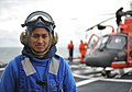 U.S. Coast Guard Seaman Leon Chingcuangco, assigned to maritime security cutter USCGC Bertholf (WMSL 750), serves as part of a helicopter tiedown crew with Coast Guard Air Station Los Angeles responsible for 120901-G-VS714-033.jpg
