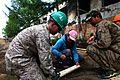 U.S. Marine Corps Lance Cpl. Taylor Tingey, left, a combat engineer with Alpha Company, 9th Engineer Support Battalion, 3rd Marine Logistics Group, assists as Mongolian Armed Forces Sgt. Amarzaya Yagaan, center 130725-M-MG222-001.jpg