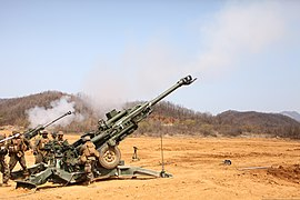 U.S. Marines with Alpha Battery, 1st Battalion, 12th Marine Regiment, 3rd Marine Division, III Marine Expeditionary Force attached to 3rd Marine Regiment, 3rd MarDiv, III MEF, fire a M777A2 155mm howitzer 130417-M-SO590-178.jpg
