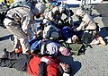 U.S. National Guardsmen assigned to the Chemical, Biological, Radiological, Nuclear and high-yield Explosives Enhanced Response Force Package, Oregon National Guard assist injured victims near Joint Base 140327-Z-CH590-233.jpg