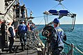 U.S. Sailors assigned to MCM Crew Dominant and deployed aboard the mine countermeasures ship USS Gladiator (MCM 11) launch a retrieval net in order to recover a SeaFox portable mine neutralization system from 130117-N-CG436-109.jpg