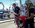 U.S. Sailors assigned to Mobile Diving and Salvage Unit 1, Company 1-2 and Thai sailors hoist a portable hyperbaric chamber during a dive medicine scenario in support of Cooperation Afloat Readiness and Training 130610-N-RG360-380.jpg