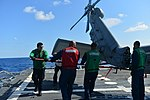 U.S. Sailors extend the tail of an MH-60R Seahawk helicopter attached to Helicopter Maritime Strike Squadron (HSM) 70 on the flight deck of the guided missile destroyer USS Truxtun (DDG 103) in the Atlantic 130807-N-YZ751-035.jpg